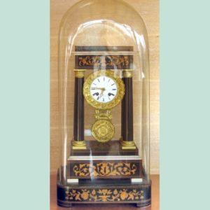 Charles X domed inlaid wood pendulum clock