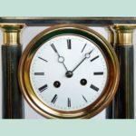 Black Napoleon III pendulum clock in a dome